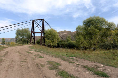Anchorages of the old bridge over the Inya River near the village of Chineta in the Altai Territory Stok Fotoğraf