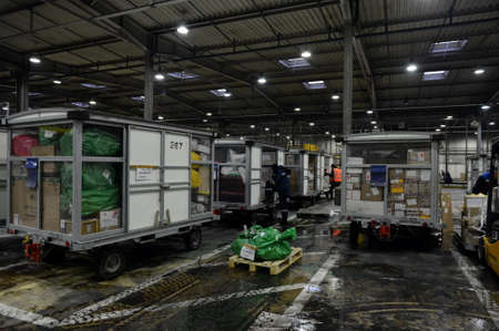 Carts with cargo to be sent from the terminal of Sheremetyevo international airport in Moscow Редакционное