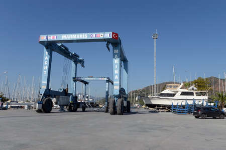 Boat wheel crane for moving yachts in the harbor of Marmaris 報道画像