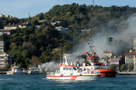 Rescue boats put out a fire on a passenger ship in the Bosphorus Редакционное