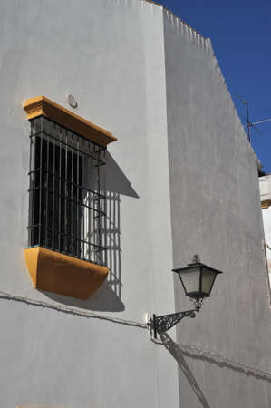 Wrought iron grating and lantern on a building in Seville