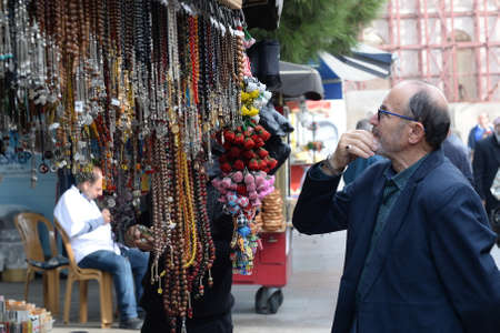 An unknown man picks up Souvenirs at a street market in Istanbul