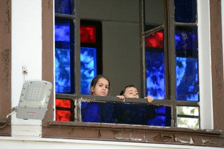 ISTANBUL, TURKEY - NOVEMBER 4, 2019: Unknown children in Turkey's main Muslim Shrine, The Sultan Eyup mosque in Istanbul