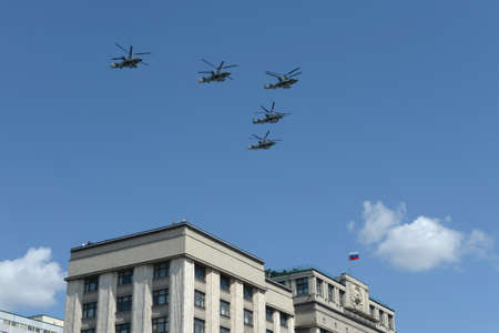 A group of Ka-52 alligator reconnaissance and attack helicopters (Hokum B) in the sky over Moscow during a parade dedicated to the 75th anniversary of the Victory Editorial