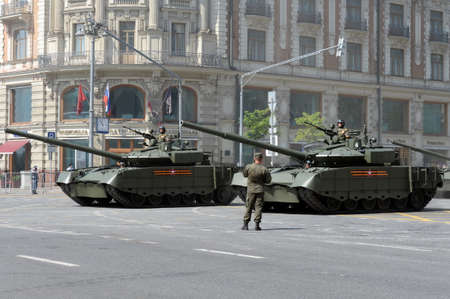 T-80BV m tanks on Tverskaya street in Moscow during the dress rehearsal of the parade dedicated to the 75th anniversary of the Victory