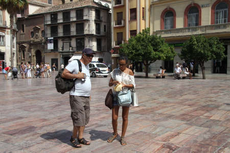 Tourists at Constitution square in the Spanish seaside city of Malaga