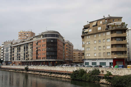 Urban view of the Spanish city of Malaga by the Guadalmedina river