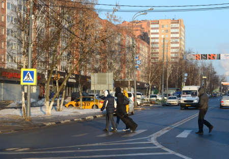 People cross the road on Marshal Nedelin Street in Odintsovo