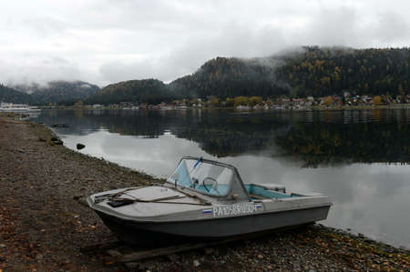 Motor boat on the shore of Lake Teletskoye in the village of Iogach. Altai Republic