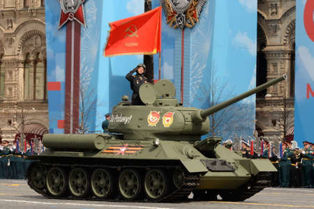 T-34-85 medium tank with a red banner on Red Square during the dress rehearsal of the parade dedicated to the 76th anniversary of Victory in the Great Patriotic War