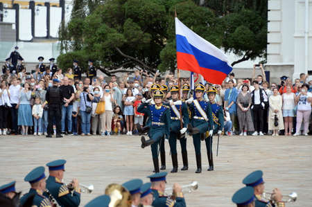 The removal of flags during the divorce ceremony of the horse and foot guards of the Presidential Regiment on the Cathedral Square of the Moscow Kremlin