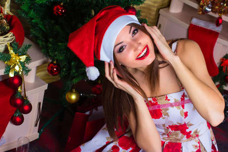 Beautiful girl in the room with Christmas decorations photo
