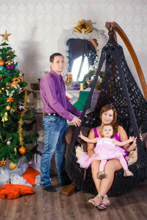 hearthside: Family before Christmas fireplace