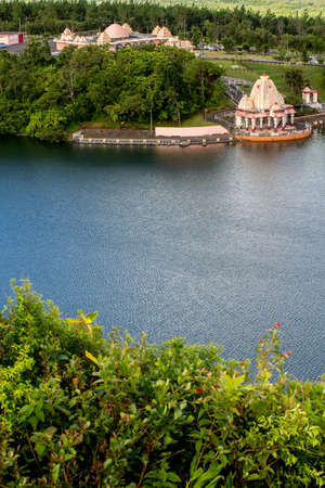 luxuriant: Hindu Temple on the banks of the blue lake Stock Photo