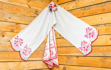 neatness: Russian painted linen towels in the red corner of the hut.