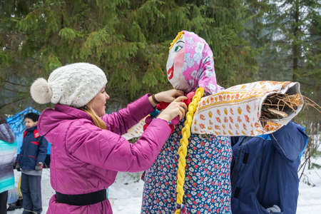 mirth: Girl decorates the effigy of Maslenitsa. Ivanovo, Russia, February 22, 2015. Editorial