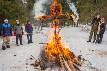 mirth: Dance around the effigy burning of the Maslenitsa. Ivanovo, Russia, February 22, 2015. On the holiday of Maslenitsa. Editorial
