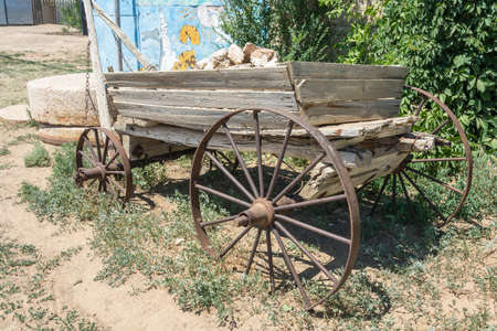 old wood farm wagon: Old wooden cart loaded with a large pile of stones. Stock Photo