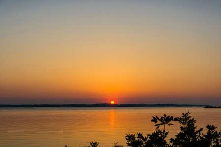 colorful sunrise: Bright colorful sunrise on the river Volga.