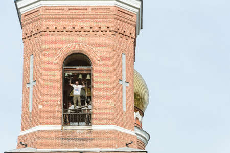 bronzy: Playing the ringer on the high bell tower of red brick in Astrakhan, June 6, 2015.