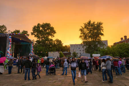 feast day: Bright yellow-orange sunset on the feast Day of the city in Kokhma, Ivanovo region, on 12 June 2014.