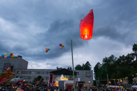 arise: Red sky lantern rises into the cloudy sky on the feast Day of the city in the town of Kokhma, Ivanovo region, on 12 June 2014.