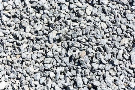 medium size: Texture gray gravel of medium size.