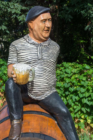 holiday movies: Fun monument actor Yevgeny Morgunov in Sochi. Sitting on a barrel with a beer in his hand.