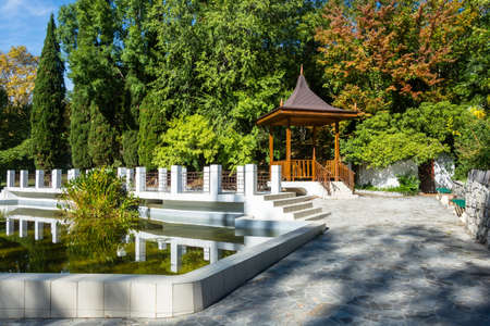 arboretum: Beautiful gazebo and pond is framed by white stone in the Park-the arboretum of Sochi.