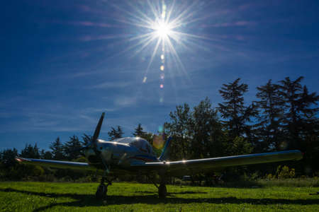 fixed wing aircraft: Single-engine plane on a small field on a Sunny day, Abkhazia.