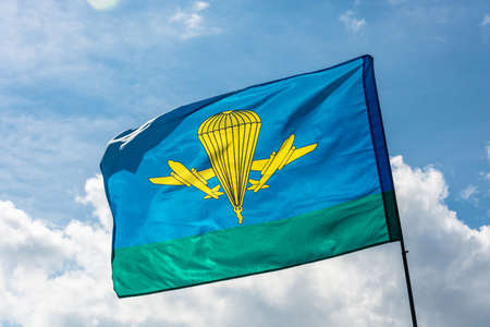 troops: Developing the flag of the Airborne troops of Russia on the background of cloudy sky.