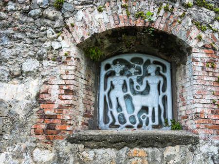 iron barred: Original metal bars on the small windows in local lore reserve Pitsunda, Abkhazia.