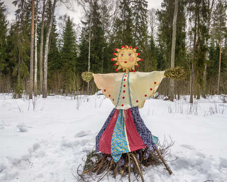 Bright beautiful effigy of the carnival at the festival Seeing the Russian winter.