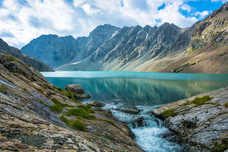 Beautiful landscape with emerald-turquoise mountain lake Ala-Kul, Kyrgyzstan.