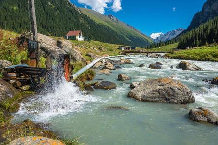 A small hydroelectric dam on a wild river Arashan, Kyrgyzstan.