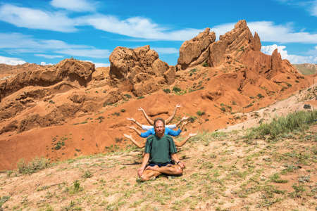 kyrgyzstan: Yoga on the background of amazing orange canyon Fairy Tale in summer sunny day, Kyrgyzstan.