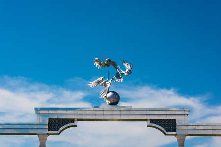 Arch Ezgulik with storks ascended up on a background of blue sky in Tashkent, Uzbekistan. Editorial
