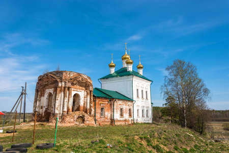 restore: Restoration of the Church of the Resurrection on a clear Sunny day in the village Stromihino, Ivanovo region, Russian Federation. Stock Photo