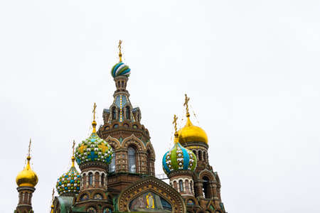 Colorful domes of the Cathedral of the Savior on the Spilled Blood in a white sky in Saint-Petersburg, Russia.