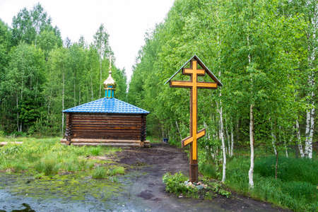 sacred source: Wooden chapel with a Golden dome on the sacred source flux in the Makariev district, Kostroma region, Russia. Stock Photo