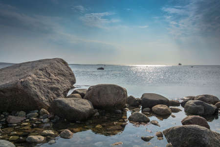 Beautiful rocky shore of the white sea in summer day.