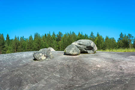 Big stone plateau with the White sea petroglyphs of Karelia, Russia.