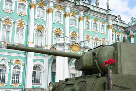 The barrel of Soviet tank T-34 close-up on background of the Winter Palace in St. Petersburg.