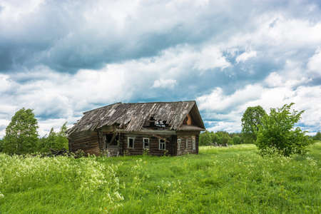 Decaying house in a non-existent village Burdovo, Kostroma oblast, Russia.