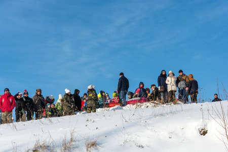 Uglich city, Yaroslavl region, Russia - 10022018: Spectators at the festival Winter fun in Uglich, 10.02.2018 in Uglich, Yaroslavl region, Russia. Редакционное