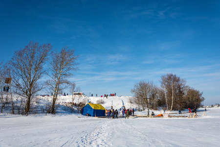 Uglich city, Yaroslavl region, Russia - 10.02.2018: Place of ice swimming competition on the Volga river, at the Winter fun festival in Uglich, 10.02.2018 in Uglich, Yaroslavl region, Russia.