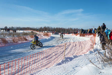 City of Uglich, Yaroslavl region, Russia - 10.02.2018: Motocross at the festival Winter fun in Uglich, 10.02.2018 in Uglich, Yaroslavl region, Russia. Редакционное