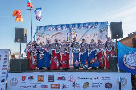 Uglich city, Yaroslavl region, Russia - 10.02.2018: Female choir at the festival Winter fun in Uglich, 10.02.2018 in Uglich, Yaroslavl region, Russia. Редакционное