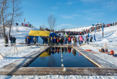 City of Uglich, Yaroslavl region, Russia - 10022018: Place, for swimming competition in icy water, at the festival Winter fun in Uglich, 10.02.2018 in Uglich, Yaroslavl region, Russia. Редакционное