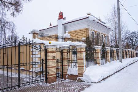 Village Vyatskoe, Yaroslavl region, Russia - February 17, 2018: Beautiful stone house with lions February 17, 2018 in the village of Vyatskoye, Yaroslavl region, Russia.